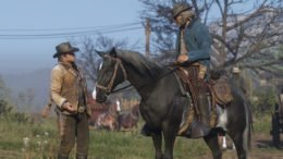 Arthur Morgan talking to someone on a horse