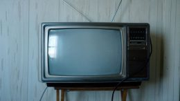 An antiquated television that ran many advertisements.
